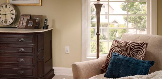 Well decorated living room with an AFCI electrical outlet located near the window