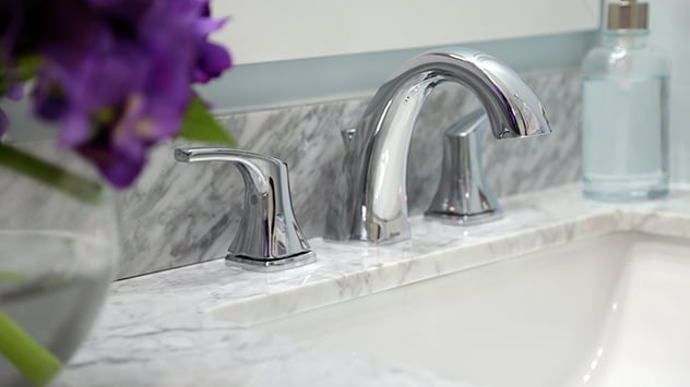 A sleek, stainless steel faucet added during the bathroom renovation