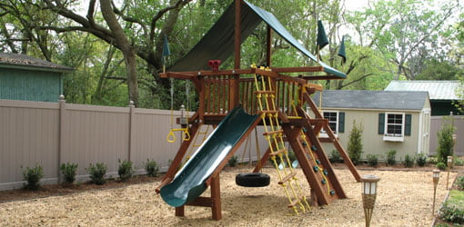 Redwood and cedar children's playset in Today's Backyard.