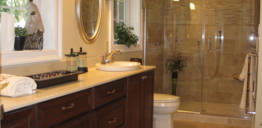 Completed major bathroom remodeling project with glass shower.