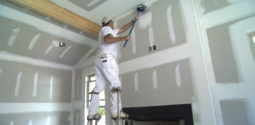 Finishing the drywall in the new family room addition.