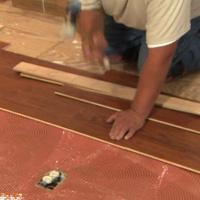 Installing hardwood flooring.
