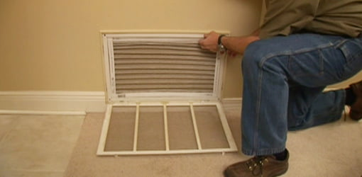 Replacing air filter on HVAC return.