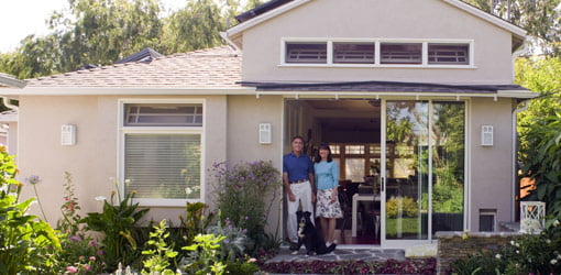 Pam Schulz and Clark Dikeman of Culver City, California, standing in front of their home addition.