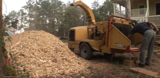 Grinding construction waste into mulch