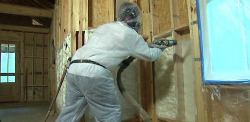 Spraying foam insulation into walls