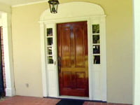New wood front entry door on home