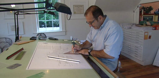 Mobile architect Pete J. Vallas hard at work on plans for the Kuppersmith house.