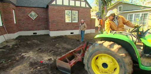 Tractor grading the lot in front of the Kuppersmith Project house