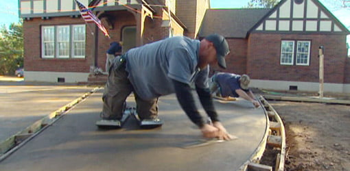 Smoothing poured concrete driveway