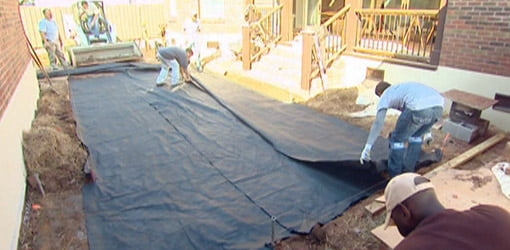Laying filter fabric for paver patio