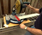Miter saw work table on ladder