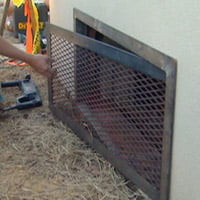 Installing steel mesh crawlspace access door