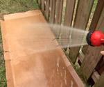 Hosing down cardboard weed barrier