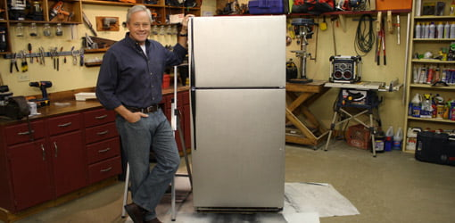 Danny Lipford standing next to refinished appliance