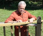Danny Lipford holding pressure treated wood
