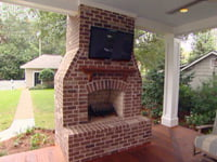 TV installed over fireplace