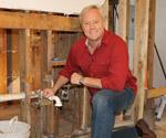 Danny Lipford next to plumbing