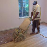 Sanding hardwood floor.
