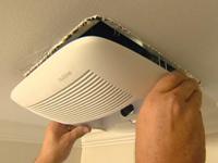 Installing bathroom vent fan.