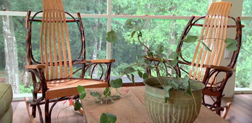 Screened porch with wooden rockers