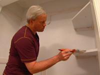 Painting closet shelves.