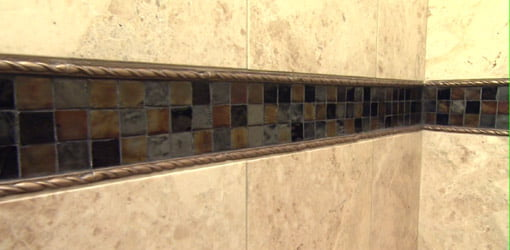 Tub surround tile with mosaic band inlay.