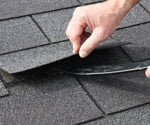 Lifting tab on asphalt roofing