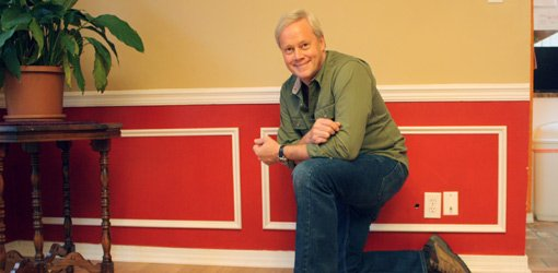 Danny Lipford with faux wainscoting installed on walls.