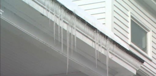 Ice dam on roof caused by poor attic ventilation.