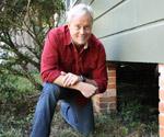 Danny Lipford kneeling by crawlspace