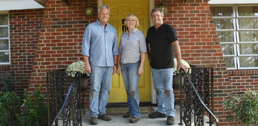 Danny Lipford, homeowner Mary Lee Montgomery, and Allen Lyle in front of home.