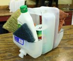 Plastic Container Tool Caddy full of cleaning supplies.