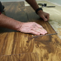 Laying resilient vinyl plank flooring