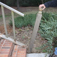 Damaged handrail post.
