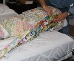 Putting duvet cover on comforter.