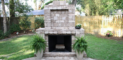 Completed outdoor paver fireplace.