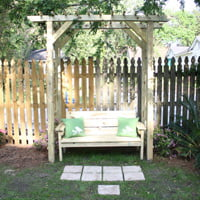 Wood arbor with bench.