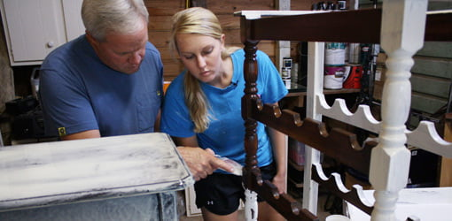 Danny and Chelsea Lipford applying decorative paint finishes to old furniture.