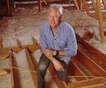 Danny Lipford in attic over garage.