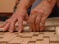 Installing Cliks tile flooring.