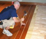 Wood flooring being installed over radiant heating system.
