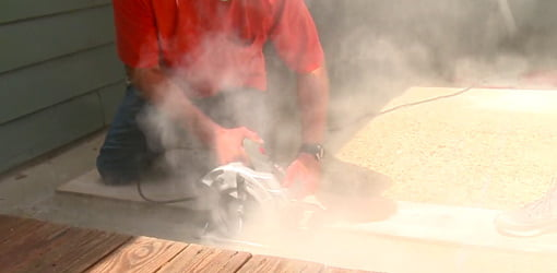 Using a circular saw with masonry blade to score decorative grooves in concrete.