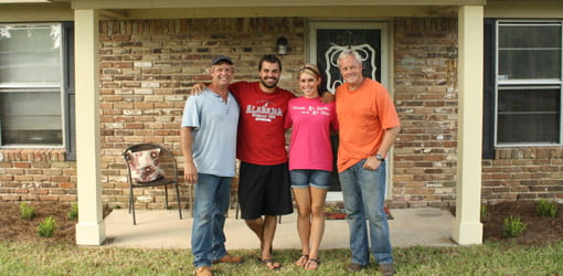 Allen Lyle and Danny Lipford with homeowners Hunter and Payton Black.