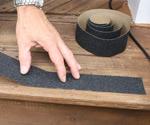 Installing step tread abrasive strips