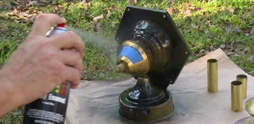 Spray painting brass outside light fixture.