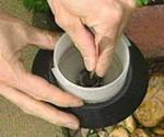 Sanding corrosion off landscape light socket.
