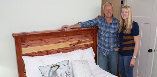 Danny Lipford and daughter, Chelsea, with headboard made from cedar tree.