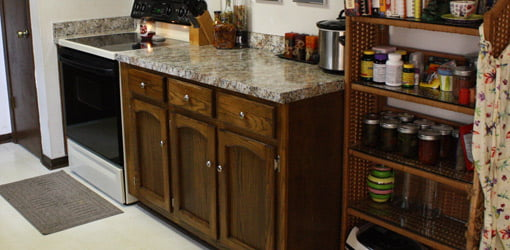 Kitchen cabinets and countertop after budget makeover.