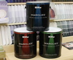 Cans of Behr Marquee exterior paint.